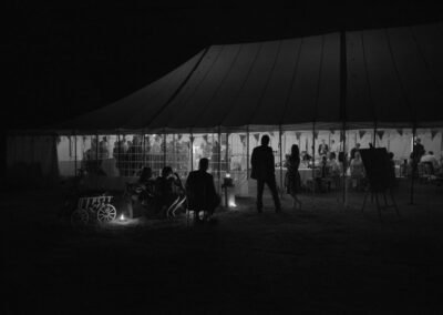 Dark night time shot of a large traditional marquee