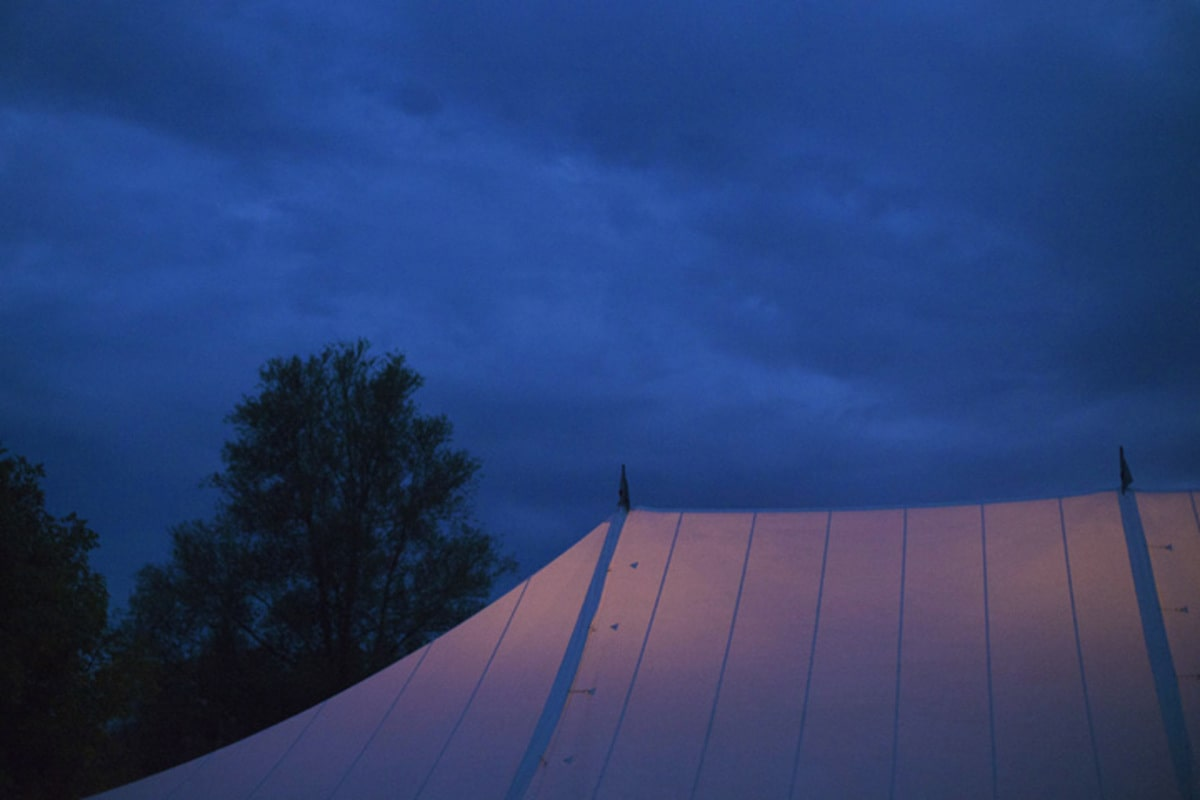 Night time, closeup exterior shot of a traditional marquee roof
