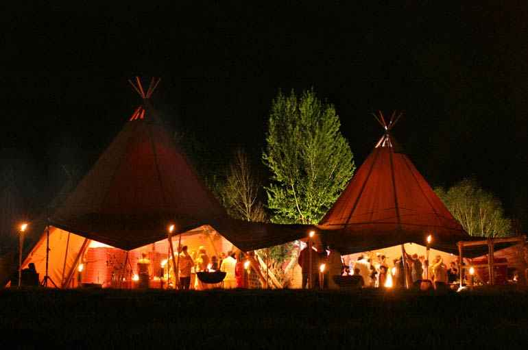 Tipis in a forest