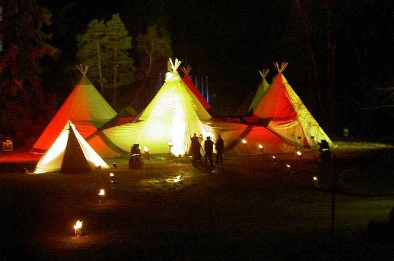 Tipis at night in a forest