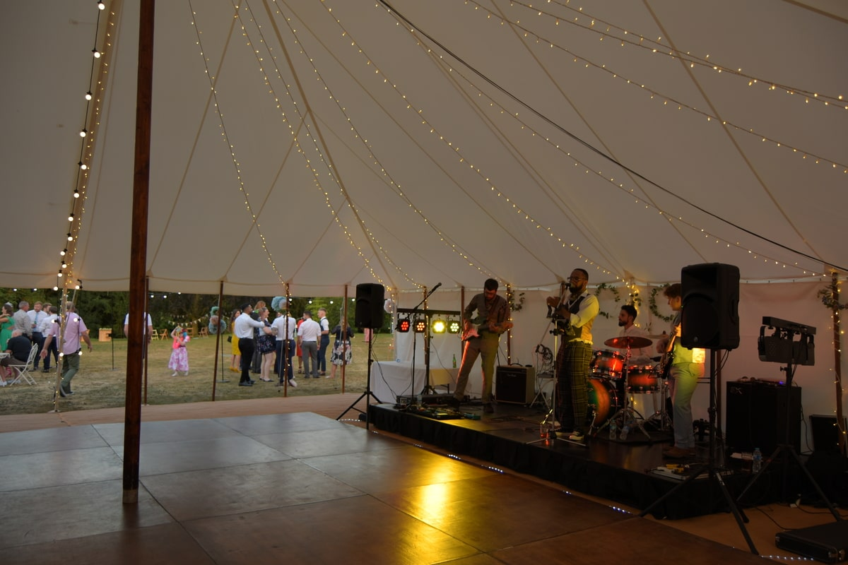 Band playing in traditional marquee