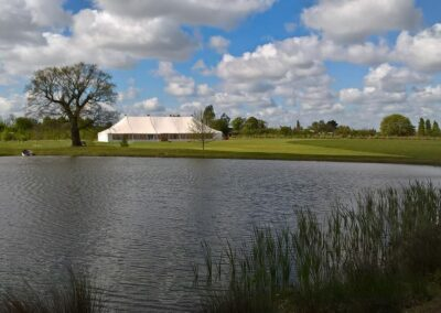 Traditional Marquee by a lake and golf club in Essex