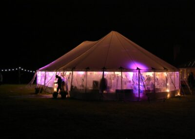Night time exterior shot of a sail cloth marquee in Essex | County Marquees East Anglia