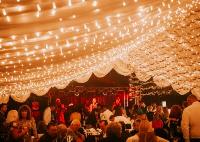 Band performing inside a wedding marquee | County Marquees East Anglia