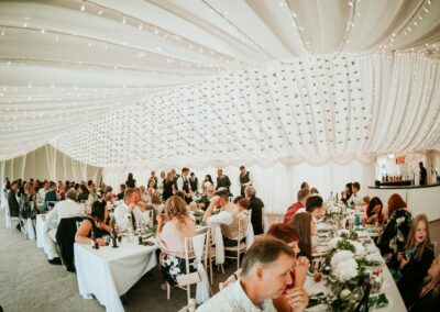 Guests dining in a clear span wedding marquee | County Marquees East Anglia