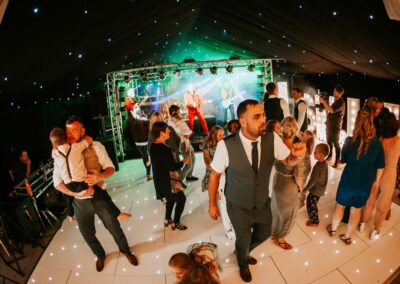 Interior shot of guests dancing inside a clear span marquee | County Marquees East Anglia