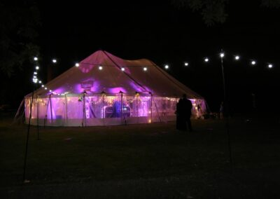 Exterior night time shot of sail cloth marquee with lights for Essex wedding | County Marquees East Anglia
