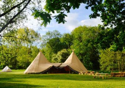 Distant view of a tipi hire in Essex | County Marquees East Anglia