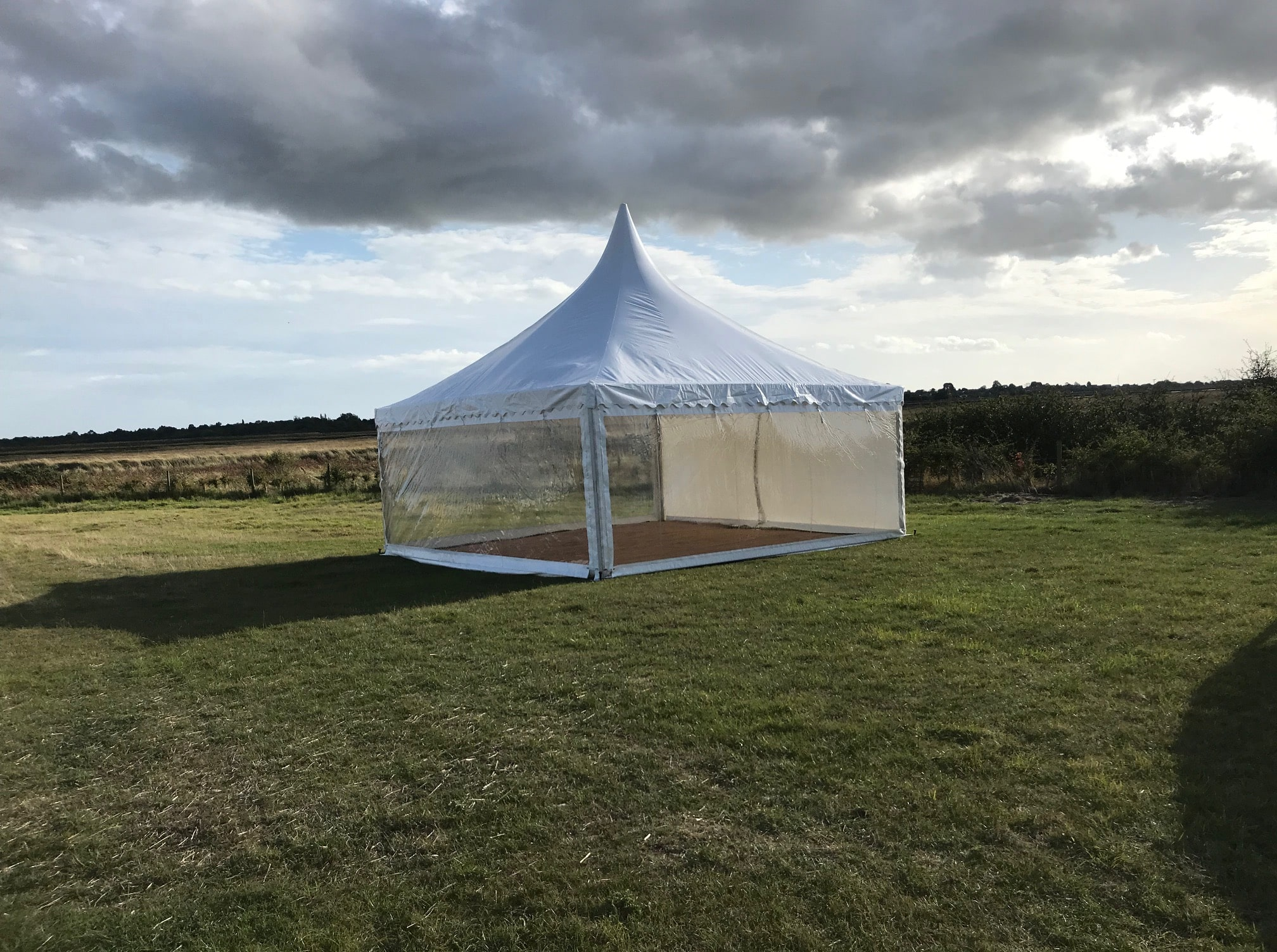 Canopies and pagodas, Chinese Hat marquee in farmers field