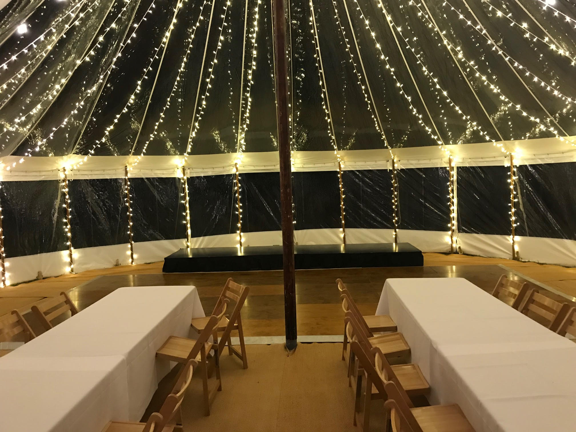 Interior shot of sail cloth marquee with festoon lighting