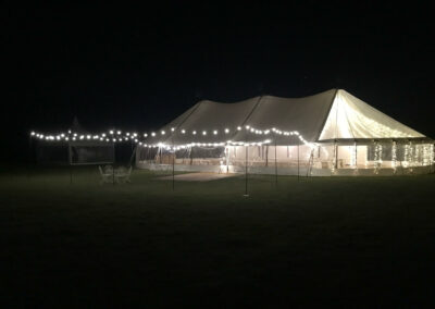 Sail cloth marquee with Festoon Light at night